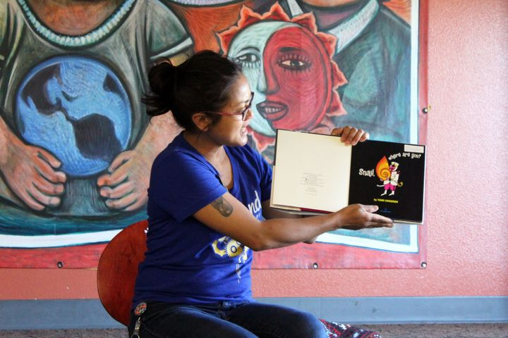 Children's librarian Annabelle Blackman reads a book titled, <i>Snail, Where Are You?</i> during her summer storytime at Cesar Chavez Public Library in Oakland, Calif.