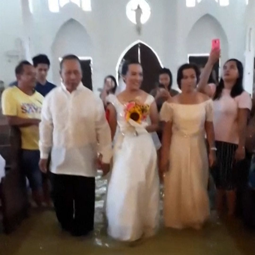 A couple waded through floodwater to have their wedding