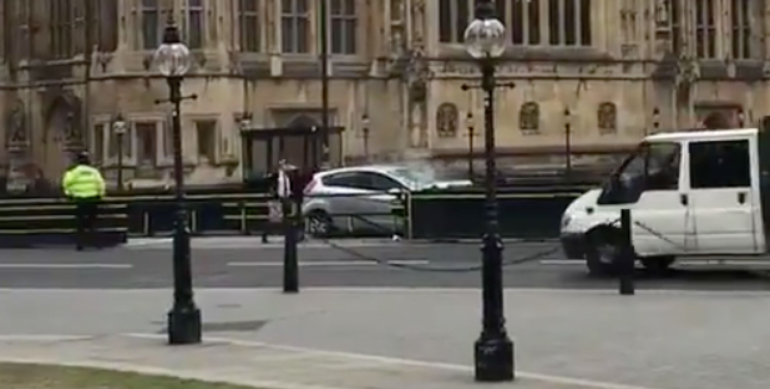 Auto  crashes into barriers outside UK Parliament