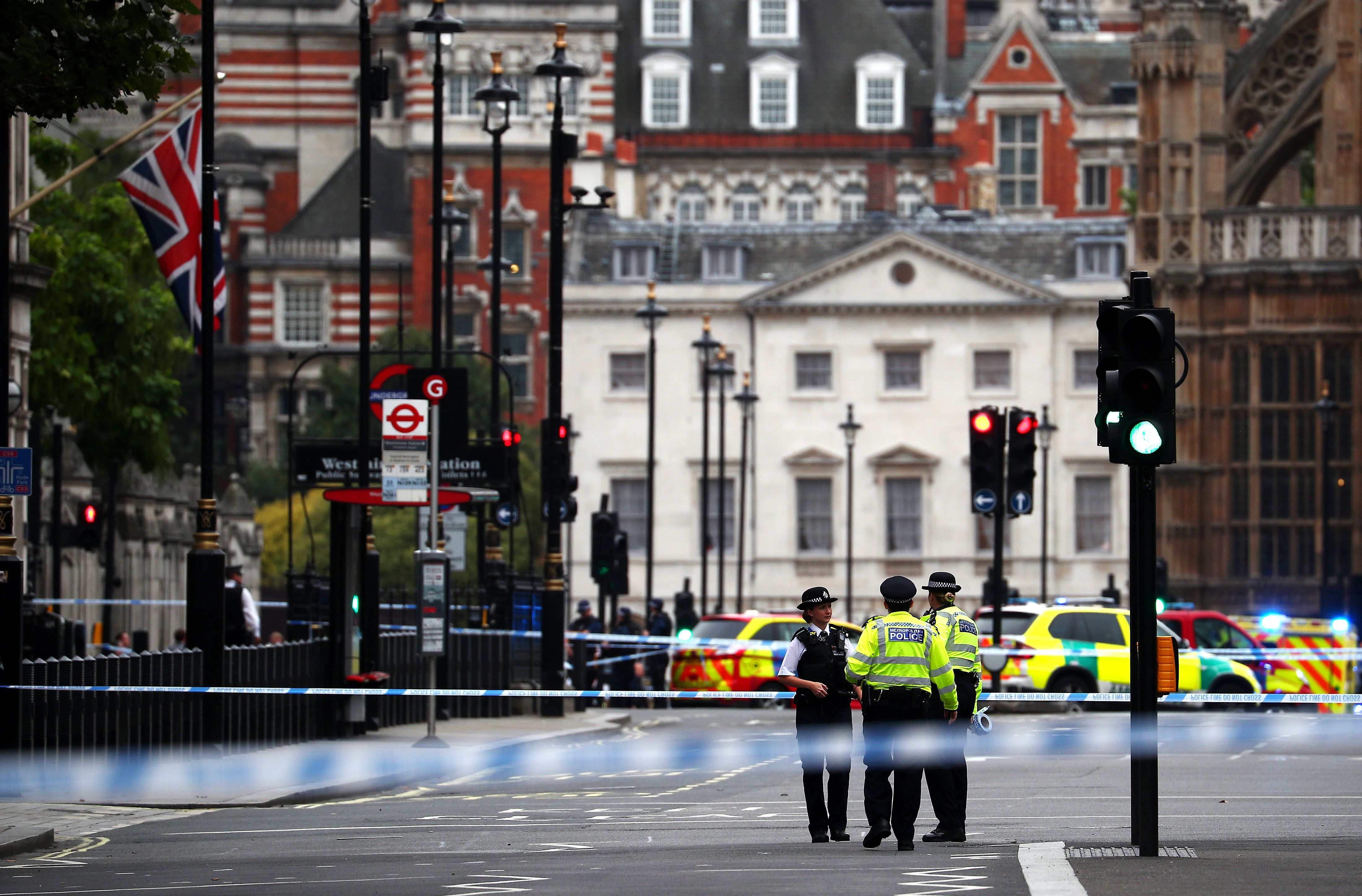 Police stand in the street after a car crashed outside the Houses of Parliament in Westminster, London, Britain, August 14, 2018. REUTERS/Hannah McKay