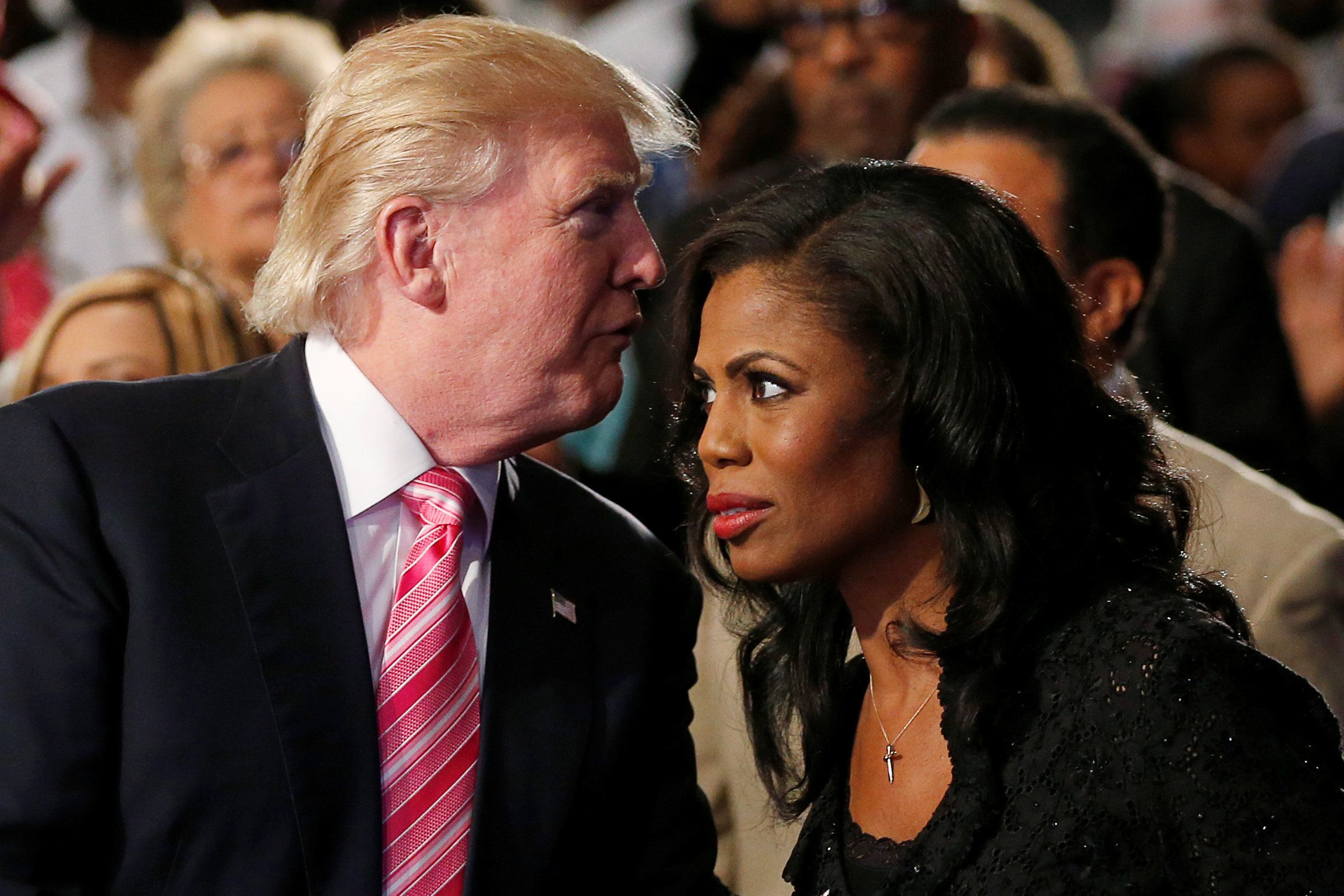 Republican presidential nominee Donald Trump and Omarosa Manigault (R) attend a church service, in Detroit, Michigan, U.S., September 3 2016.   REUTERS/Carlo Allegri