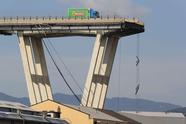 A lorry sits on the Morandi motorway bridge after it collapsed.