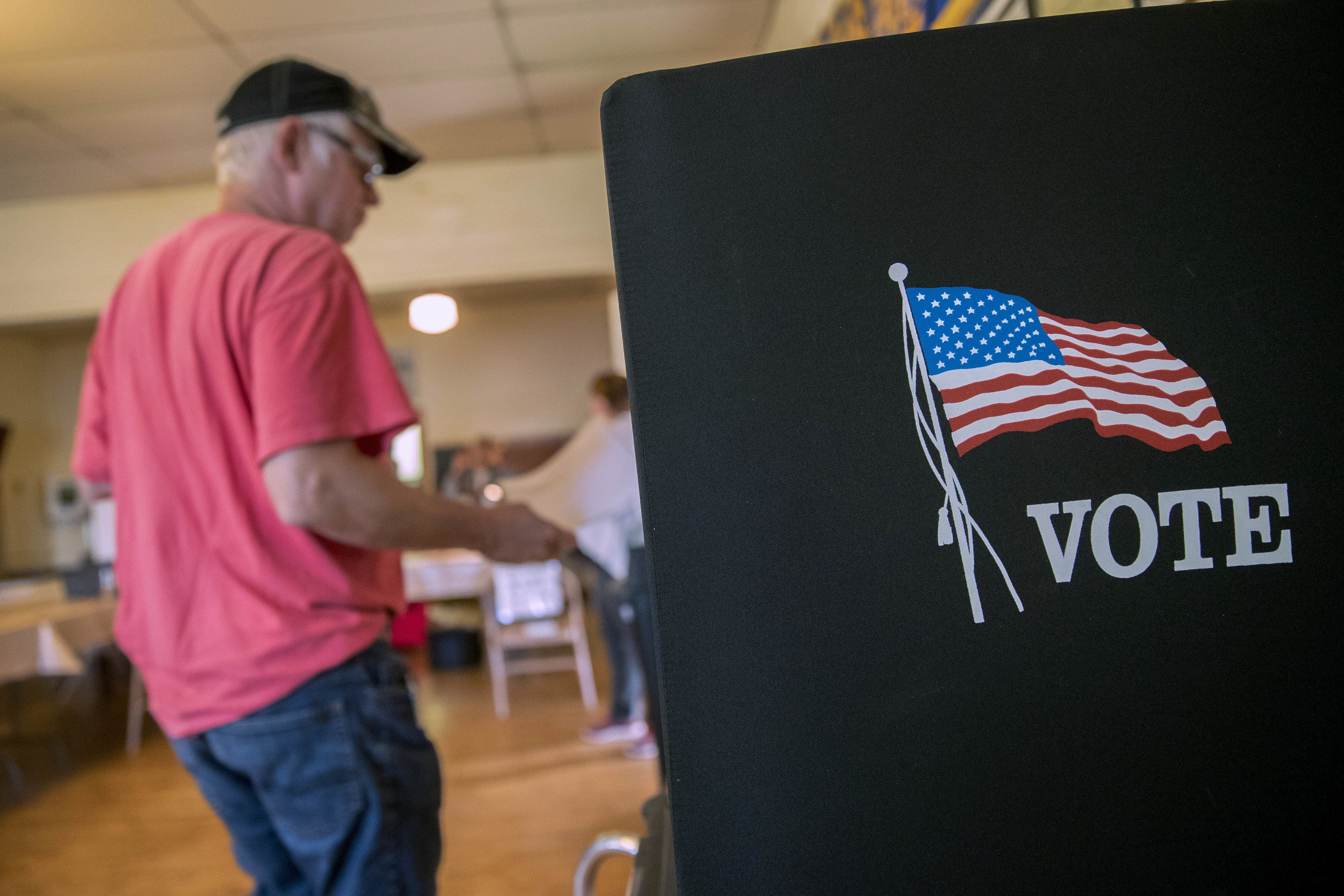 A voter arrives at a booth to fill out ballot at a polling location during the primary election in Lebanon Church, Virginia, U.S., on Tuesday, June 12, 2018. In the Shenandoah Valley's 6th Congressional district, four Democrats are running in the primary for the open seat being vacated by retiring Republican Bob Goodlatte. Photographer: Andrew Harrer/Bloomberg via Getty Images
