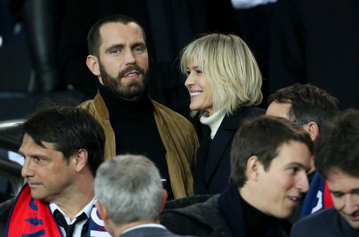 Robin Wright and Clement Giraudet attend the UEFA Champions League Round of 16 Second Leg match between Paris Saint-Germain a
