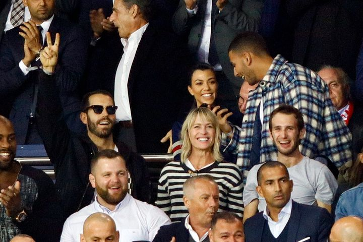 Robin Wright, Clement Giraudet and Hopper Penn during a soccer match in Paris on Sept. 27, 2017.Kourtney Kardashian and her ex-boyfriend Younes Bendjima sat behind the trio.