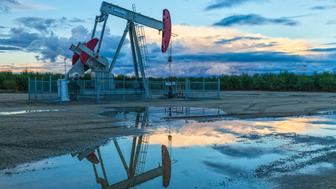 A pump jack and surface water at oil well and fracking site in Shafter. Kern County, located over the Monterey Shale, has seen a dramatic increase in oil drilling and hydraulic fracking in recent years. San Joaquin Valley, California. (Photo by: Citizens of the Planet/Education Images/UIG via Getty Images)