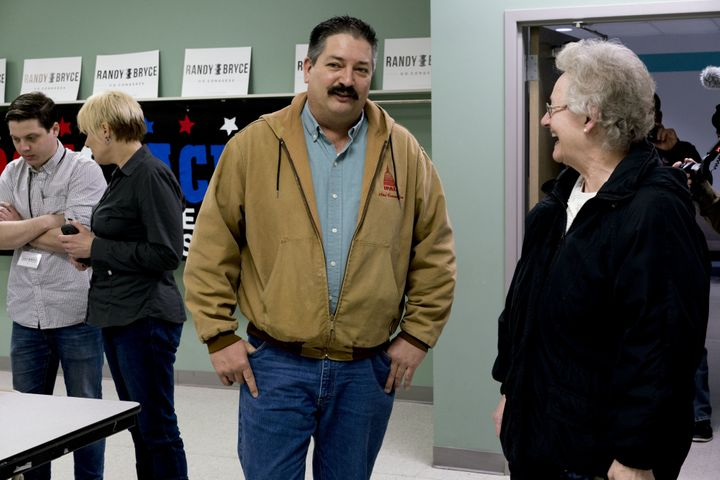 Randy Bryce speaks with a campaign volunteer at an event in Kenosha, Wisconsin, in April.