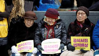 Former South Korean 'comfort women' attend an anti-Japan rally on the day of the 98th anniversary of the Independence Movement Day in Seoul, South Korea, March 1, 2017. The women are holding signs demanding a formal apology and legal reparations from Japan. REUTERS/Kim Hong-Ji     TPX IMAGES OF THE DAY