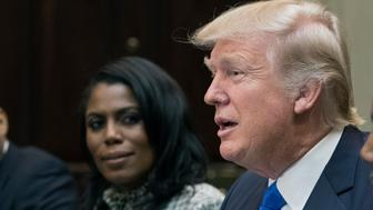 WASHINGTON, DC - FEBRUARY 1:  (AFP OUT) President Donald Trump holds an African American History Month listening session attended by nominee to lead the Department of Housing and Urban Development (HUD) Ben Carson (R), Director of Communications for the Office of Public Liaison Omarosa Manigault (L) and other officials in the Roosevelt Room of the White House on February 1, 2017 in Washington, DC. (Photo by Michael Reynolds - Pool/Getty Images)