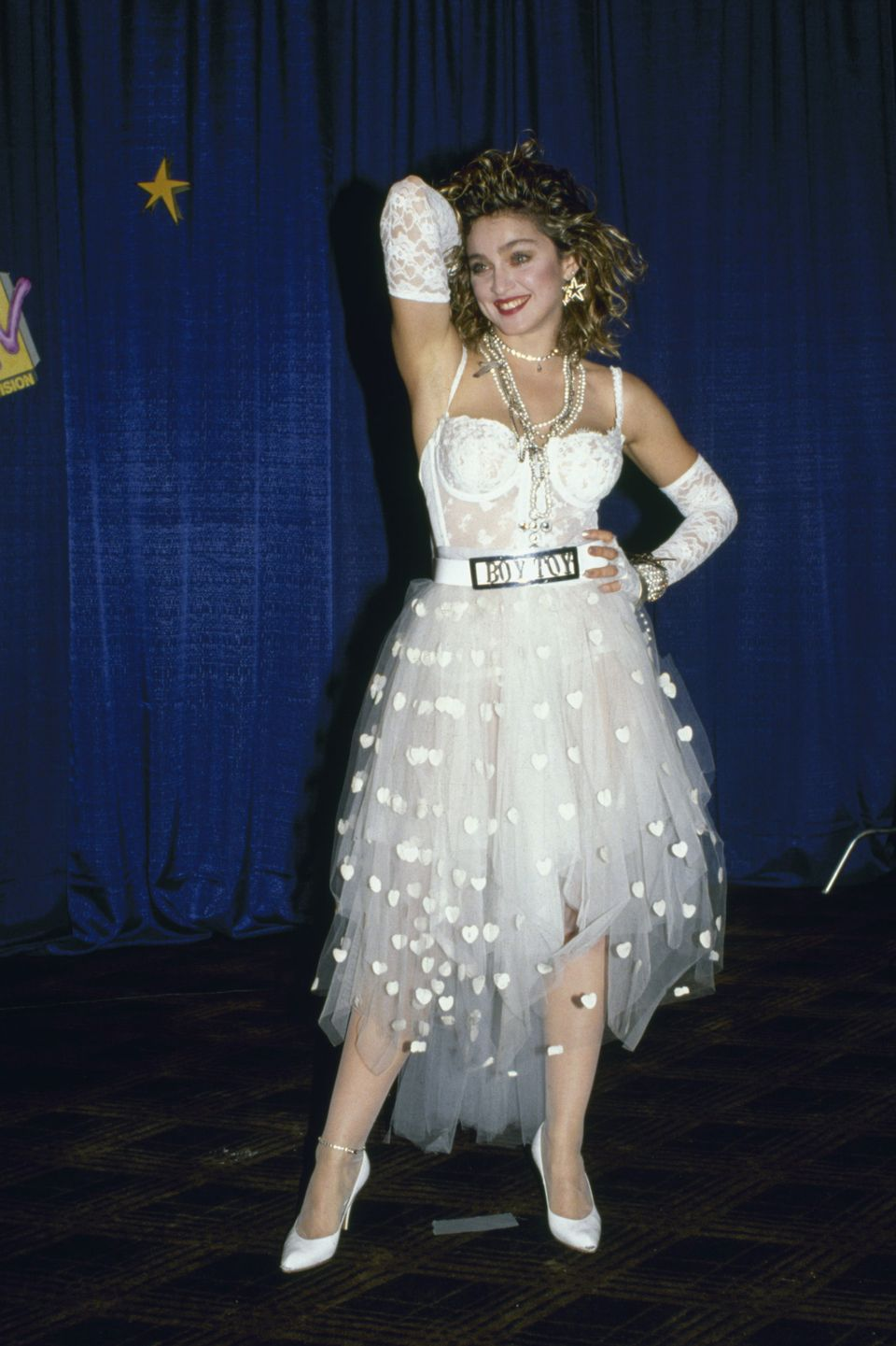 """This ensemble, with a lace bustier, tulle skirt and, of course, """"boy toy"""" belt buckle is, hands down, one of Madg"""