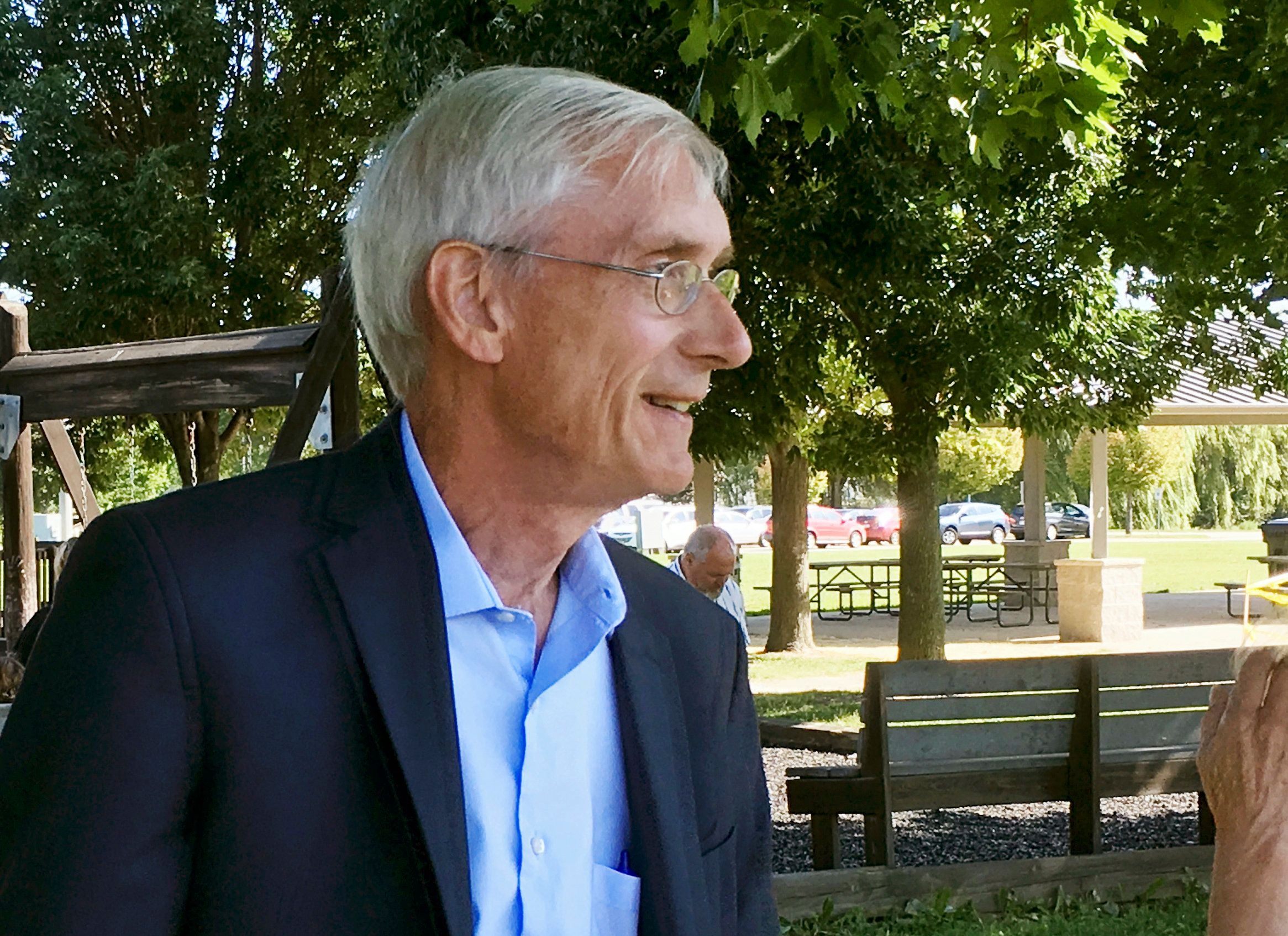 Wisconsin state schools Superintendent Tony Evers greets supporters at a park in Fitchburg, Wis., on Wednesday, Aug. 23, 2017, moments before announcing he will run for governor in 2018. (AP Photo/Todd Richmond)