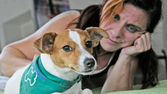 Marcela Alvarez lives in a high-rise condominium on Miami Beach, with her Jack Russell terrier, Pelusa, who is considered an emotional support animal. (Marcie Cohn Band/Miami Herald/MCT via Getty Images)