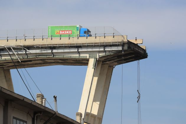 A lorry sits on the edge of the Morandi viaduct in Genoa, where a 260-foot span of highway broke away...
