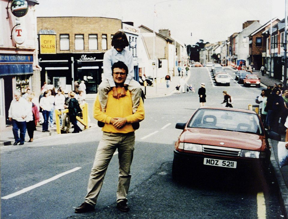 Completely unaware of its contents, a man and a child stopped for a photograph next to the car full of...
