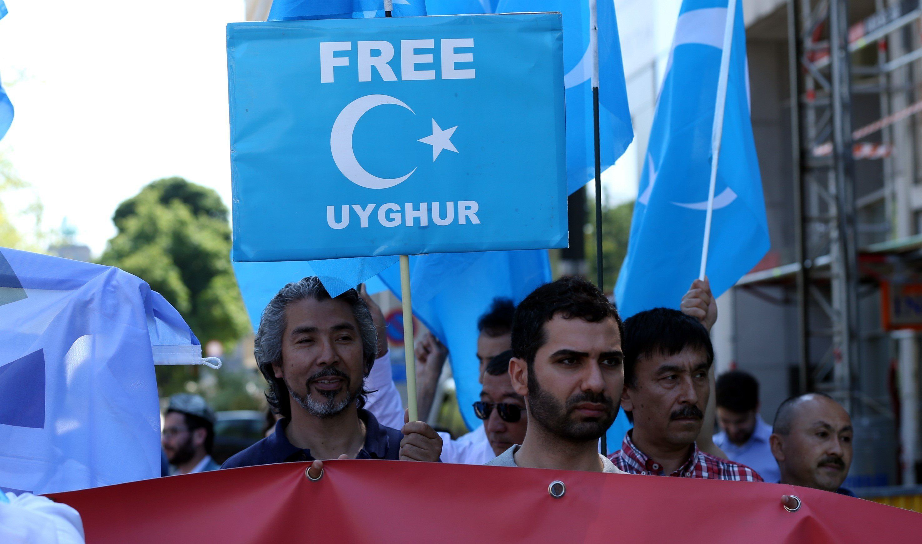 BRUSSELS, BELGIUM - JUNE 02 : Tibetan and Uyghur Turks hold banners and placards during a protest against Chinese Premier Li Keqiang after he attended EU-China Summit, in front of the EU Council Building in Brussels, Belgium on June 02, 2017. (Photo by Dursun Aydemir/Anadolu Agency/Getty Images)