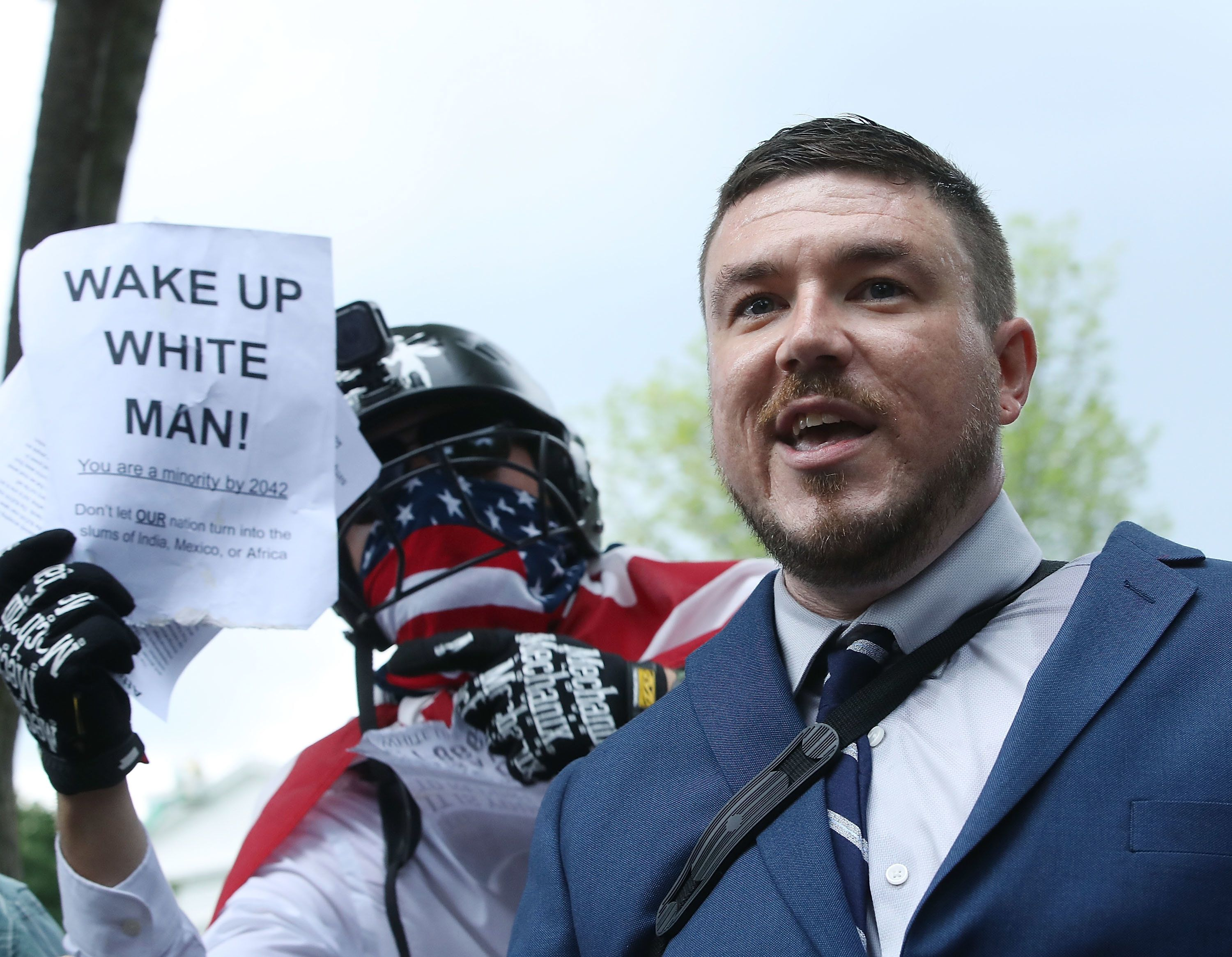 WASHINGTON, DC - AUGUST 12:  Jason Kessler (C), who organized the rally, speaks as white supremacists, neo-Nazis, members of the Ku Klux Klan and other hate groups gather for the Unite the Right rally in Lafayette Park across from the White House August 12, 2018 in Washington, DC. Thousands of protesters are expected to demonstrate against the 'white civil rights' rally, which was planned by the organizer of last yearÕs deadly rally in Charlottesville, Virginia  (Photo by Mark Wilson/Getty Images)