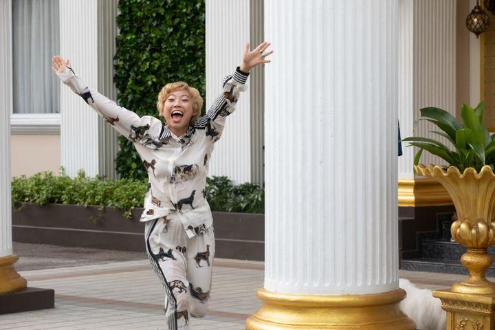 Peik Lin, played by Awkwafina, wearing a silk pajama-inspired ensemble by Stella McCartney.