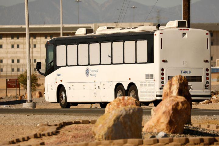 Asylum-seekers arrive at the federal prison in Victorville, California, on June 8, 2018.