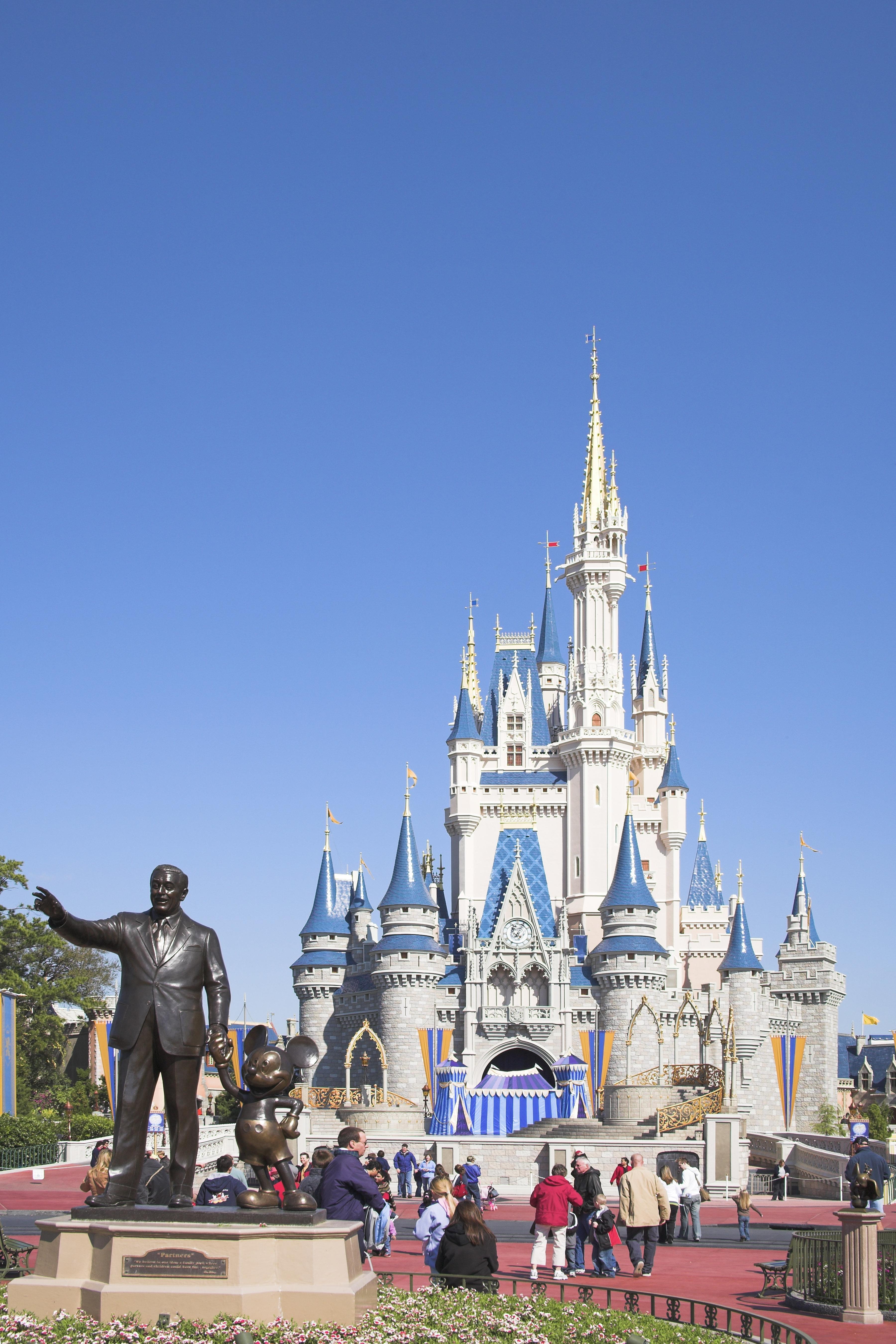 Walt Disney and Mickey Mouse Partners statue and Cinderella Castle, Magic Kingdom, Orlando, Florida, USA