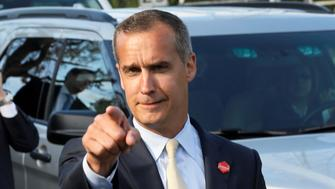"""Former campaign manager Corey Lewandowski (C) says hello to reporters as he and White House advisors Sebastian Gorka (from L), Omarosa Manigault, White House Staff Secretary Rob Porter and Communications Director Anthony Scaramucci accompany President Trump for an event celebrating veterans at AMVETS Post 44 in Struthers, Ohio, U.S., July 25, 2017. Jonathan Ernst: """"The most visible person in any White House is naturally the President, followed by the press secretary. But there are also the staff who support them, any one of whom might suddenly jump into public view and be national news for a day or two. For those of us covering the President Trump administration, there seem to be more compelling figures in the West Wing than ever before. It's crucial to know who's who and why they're important. When I raised my camera and back-pedalled ahead of the group to take this image Lewandowski gave me a hello and pointed right into the lens. I liked the photo, but had no idea it would go a little bit viral, especially since Scaramucci, who was the biggest mover and shaker that week, was hidden back in the pack. But I guess the image catches a glimpse of what it's like to be a West Wing staffer on the road.""""REUTERS/Jonathan Ernst/File photo  SEARCH """"POY STORY"""" FOR THIS STORY. SEARCH """"REUTERS POY"""" FOR ALL BEST OF 2017 PACKAGES. TPX IMAGES OF THE DAY."""