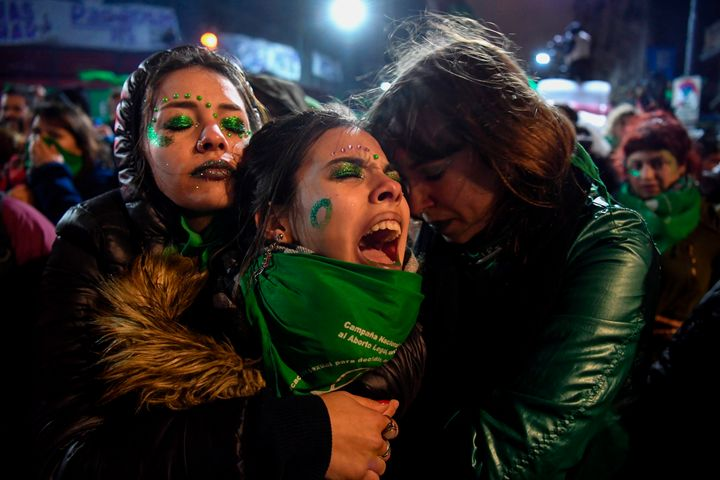 Activists in favor of the legalization of abortion comfort each other outside the National Congress in Buenos Aires on Aug. 9