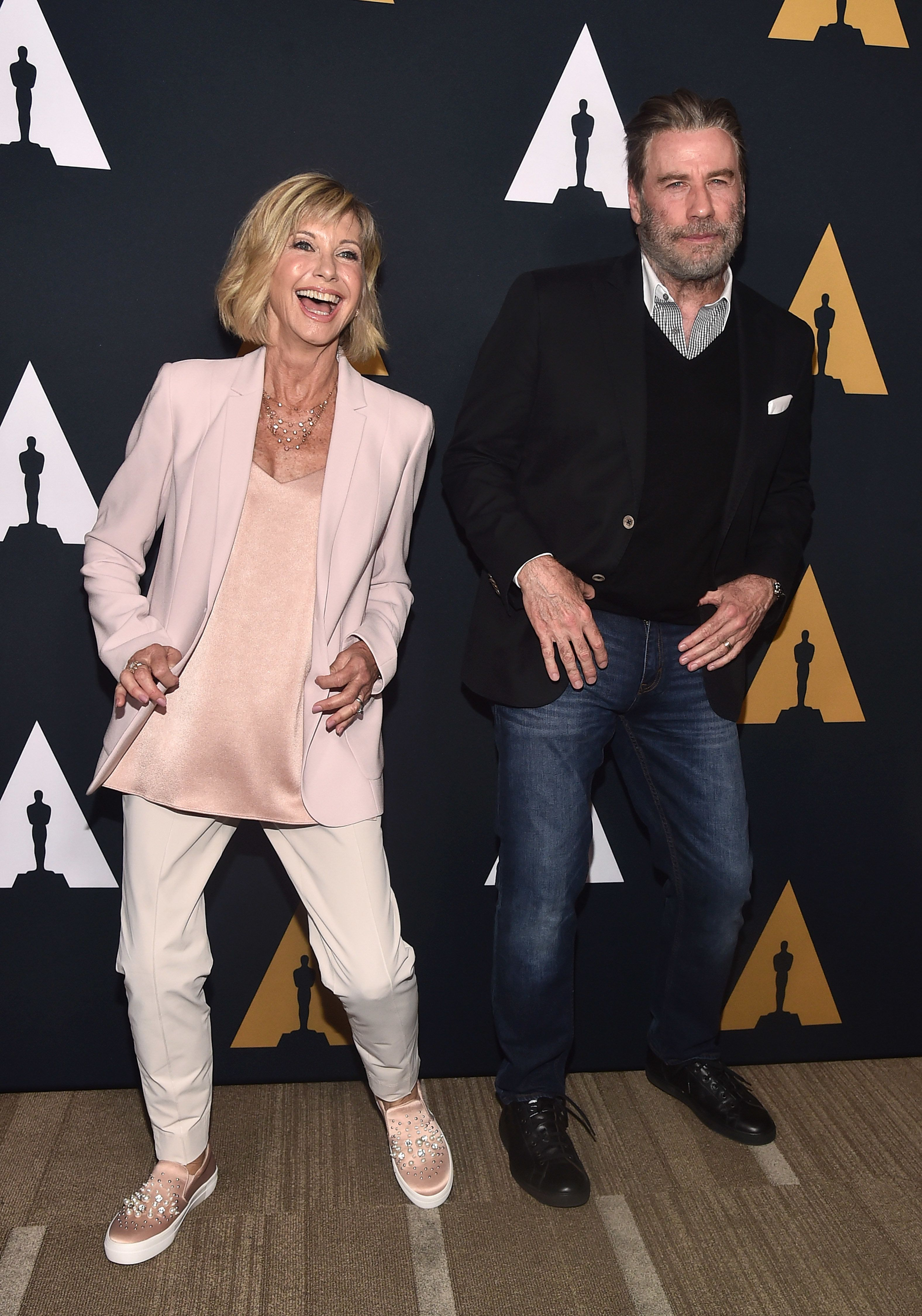 BEVERLY HILLS, CA - AUGUST 15:  Olivia Newton-John and John Travolta attend the Academy Presents 'Grease' (1978) 40th Anniversary at the Samuel Goldwyn Theater on August 15, 2018 in Beverly Hills, California.  (Photo by Alberto E. Rodriguez/Getty Images)