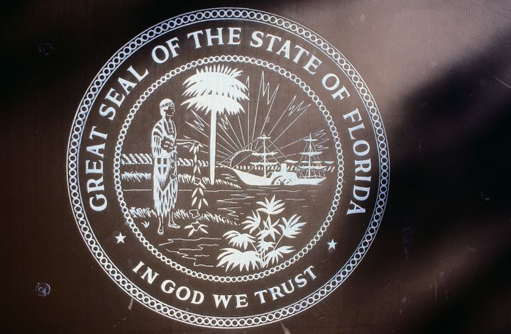 """In God We Trust"" has been Florida's state motto since 2006. It is now mandatory to display in all public schools"