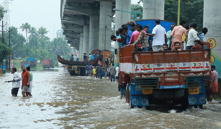 Commuters travel on a truck in theErnakulam district of Kochi.