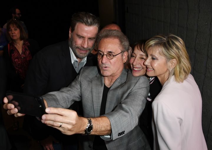 Didi Conn, Randal Kleiser, Olivia Newton-John, John Travolta and Barry Pearl pose for a selfie.