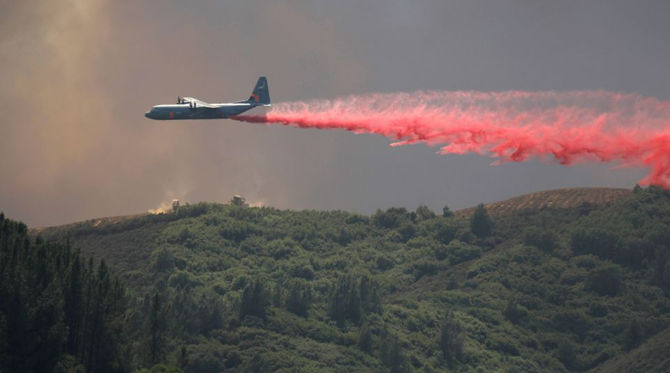 A tanker drops fire retardant on the fire near Lakeport, California, on 1