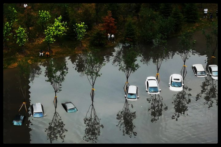 Cars were nearly fully submerged in Shenyang in 7 August.
