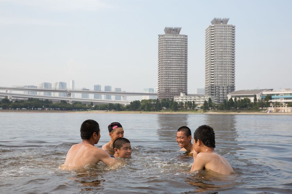 People cool off in a Tokyo park on 22