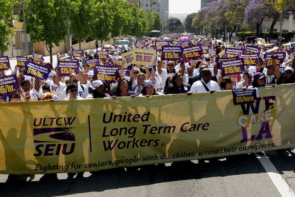 LOS ANGELES, CA - APRIL 14: More than a thousand L.A. County homecare workers march past the county administration building downtown to call for a hike in the minimum wage to $15 per hour on Tuesday, April 14, 2015 in Los Angeles, California. Representatives of organized labor, including the Service Employees International Union, claim that the current hourly wage of $9.95 is not enough for workers to support their families and keeps many people mired in poverty.  (Photo by Luis Sinco/Los Angeles Times via Getty Images)