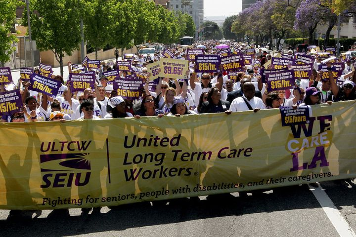 Home care workers march in Los Angeles in April 2015 calling for a minimum wage hike.