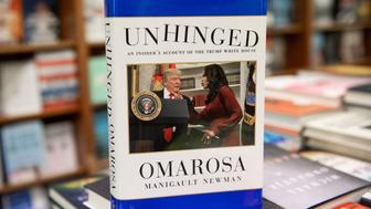 'Unhinged,' the new tell-all book by former White House aide Omarosa Manigault Newman, is for sale at the Politics and Prose bookstore in Washington, DC, on August 14, 2018. (Photo by SAUL LOEB / AFP)        (Photo credit should read SAUL LOEB/AFP/Getty Images)