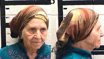 This Friday, Aug. 10, 2018 photo released by the Murray County Jail, Ga. shows Martha Al-Bishara, 87, under arrest. Al-Bishara was charged with criminal trespass and obstructing an officer Friday when police held her at gunpoint before bringing her to the ground with a jolt from the electrified prongs of a stun gun. Officers used the taser on Al-Bishara when she didn't obey commands to drop a knife in her hand. Relatives said Al-Bishara does't speak English and was merely cutting out dandelions with a kitchen knife near her home in Chatsworth. (Murray County Jail via AP)