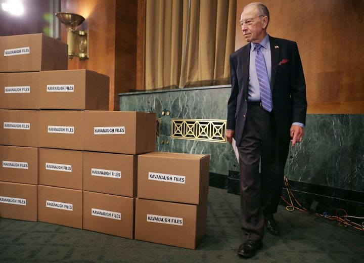 Senate Judiciary Committee Chairman Chuck Grassley (R-Iowa) walks out from behind a wall of empty boxes labeled 'Kavanaugh Fi