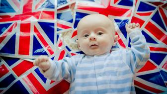 Baby celebrating the royal wedding