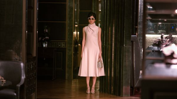 Astrid Young Teo (Gemma Chan) wearing a pastel pink Dior dress.