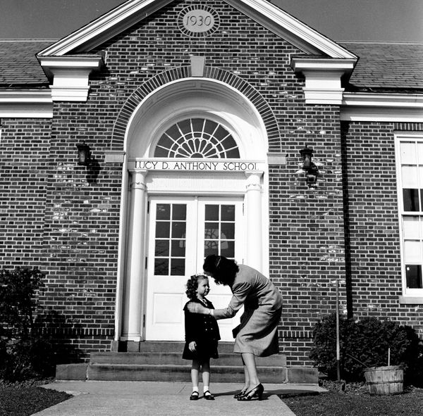 In 1948, a young girl shares a moment with her mother outside the Lucy D. Anthony school in Madison, New Jersey.