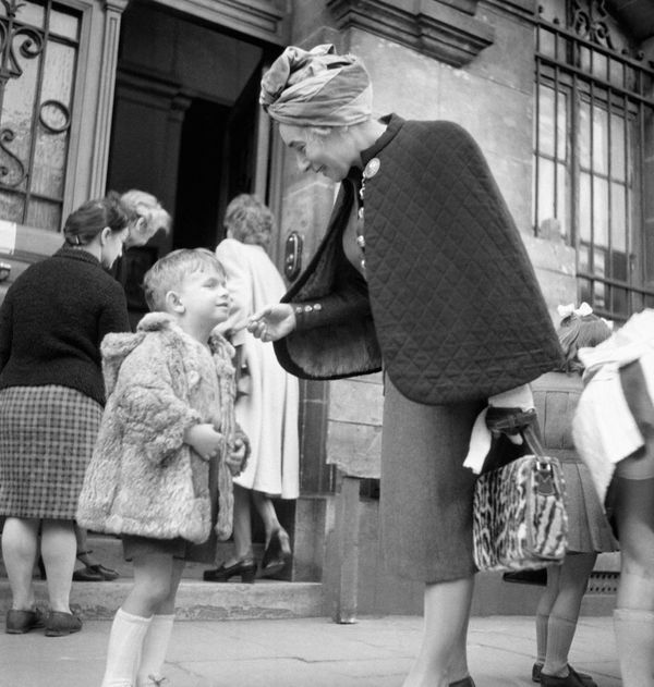 A little boy in Paris says goodbye to his mother outside a school in September 1945.