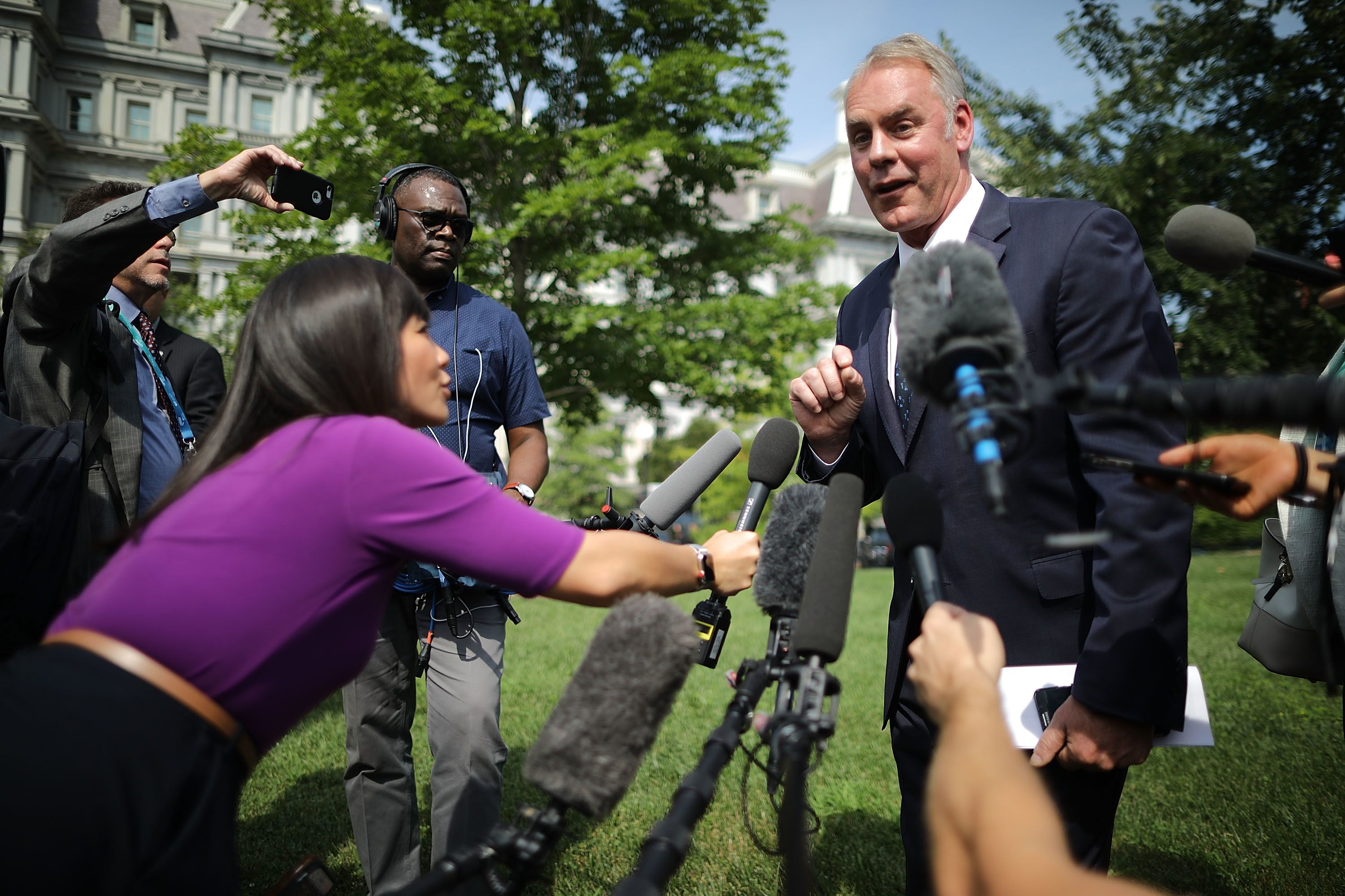 WASHINGTON, DC - AUGUST 16:  Interior Secretary Ryan Zinke talks to journalists outside the White House West Wing before attending a cabinet meeting with President Donald Trump August 16, 2018 in Washington, DC. Zinke said the historic wild fires in the west are caused by mismanaged public lands and 'environmental terrorists groups' that work to prevent logging and clearing dead trees and debris that fuel fires.   (Photo by Chip Somodevilla/Getty Images)