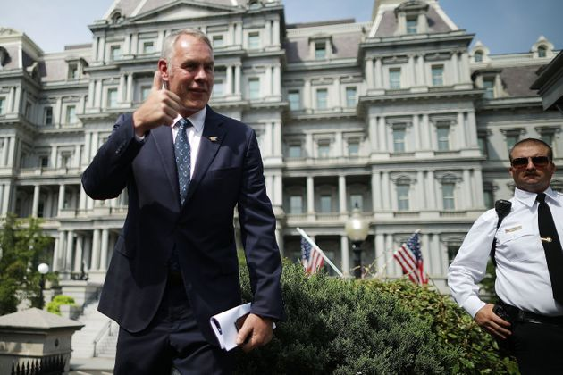 Interior Secretary Ryan Zinke talks to journalists outside the White House West Wing before attending...