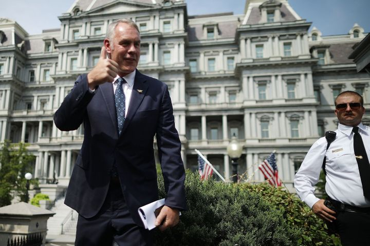 Interior Secretary Ryan Zinke talks to journalists outside the White House West Wing before attending a Cabinet meeting with