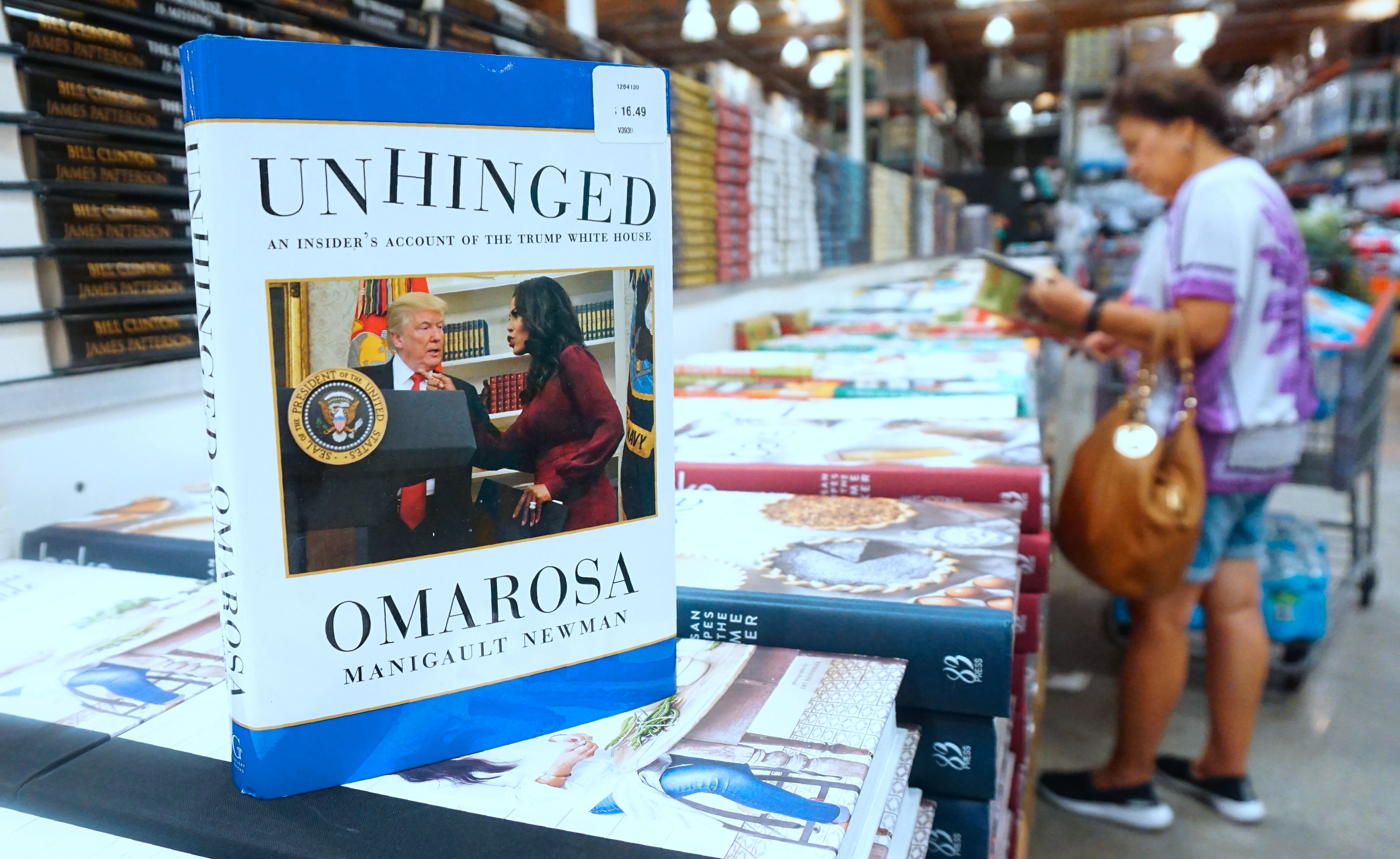 Omarosa Manigualt-Newman's newly released book 'Unhinged' is displayed and for sale in Alhambra, California on August 4, 2018. - The former reality TV participant and political aide to the Trump government has been accused by the Trump campaign of violating a 2016 confidentiality agreement with her tell-all book and publicity tour. (Photo by Frederic J. BROWN / AFP)        (Photo credit should read FREDERIC J. BROWN/AFP/Getty Images)