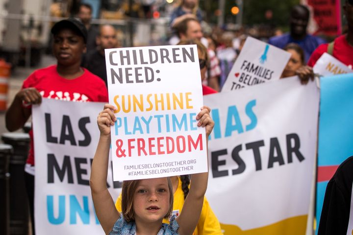 Demonstrators protest against the Trump administration's immigration policies, which resulted in more than 2,500 children bei
