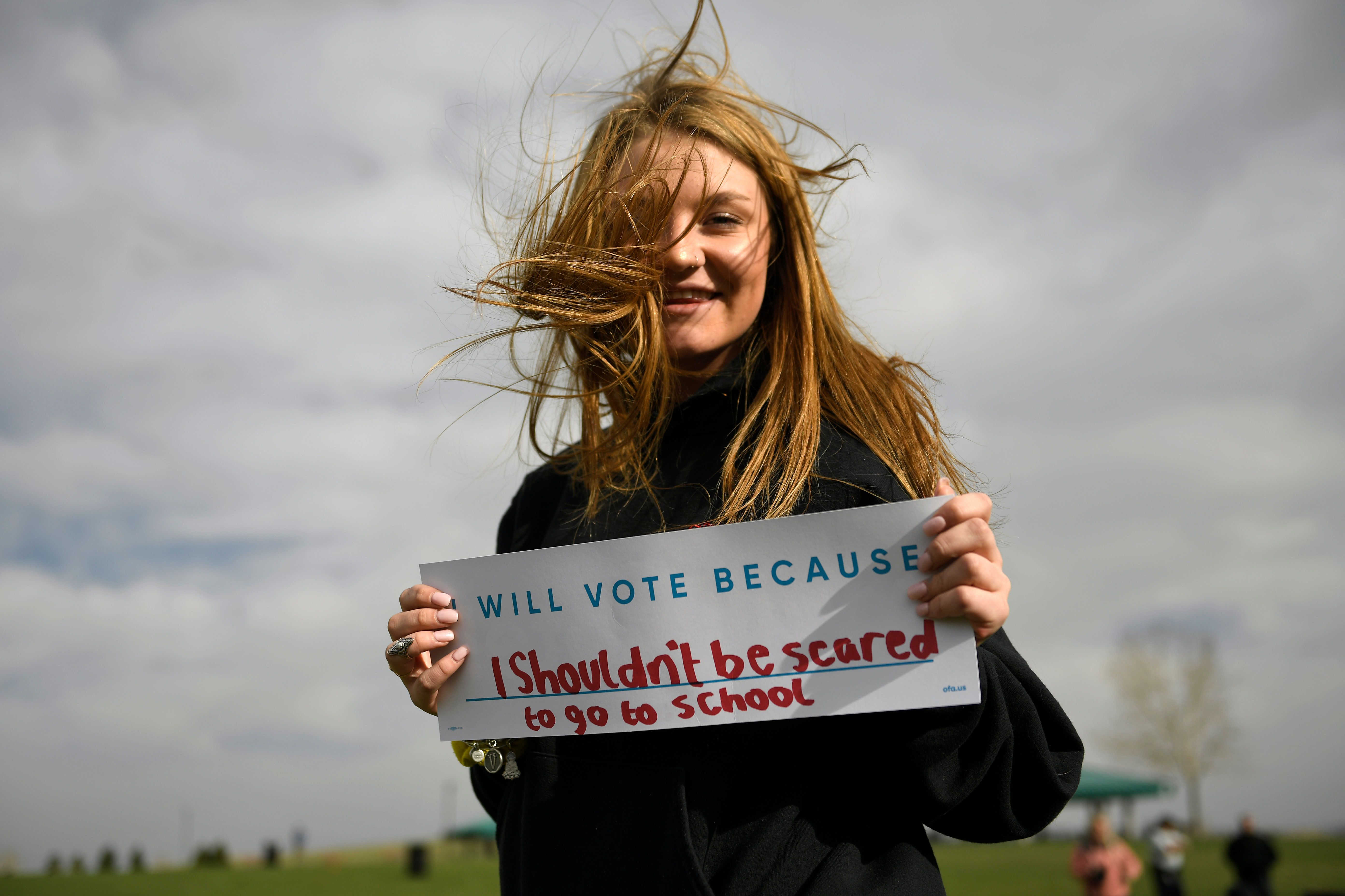 LITTLETON, CO - APRIL 19: 10th grader Caitlyn Bedenbender 16, of Littleton with her sign as students from Marjory Stoneman Douglas High School, Pittsburgh, Columbine as well as survivors from Arapahoe and Aurora during the Vote for Our Lives event at Clement Park Amphitheater  April 19, 2018 Littleton, CO (Photo by Joe Amon/The Denver Post via Getty Images)