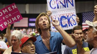 TAMPA, FL - JULY 31:  People make themselves heard as CNN broadcasts before the arrival of President Donald Trump for his Make America Great Again Rally at the Florida State Fair Grounds Expo Hall on July 31, 2018 in Tampa, Florida.  Before the rally, President Trump was scheduled to visit the Tampa Bay Technical High School for a roundtable discussion on Workforce Development in Tampa.   (Photo by Joe Raedle/Getty Images)