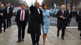 President Donald Trump and first lady Melania Trump walk along the Inauguration Day parade route after being sworn in as the 45th President of the United States, Friday, Jan. 20, 2017, in Washington. REUTERS/Evan Vucci-Pool