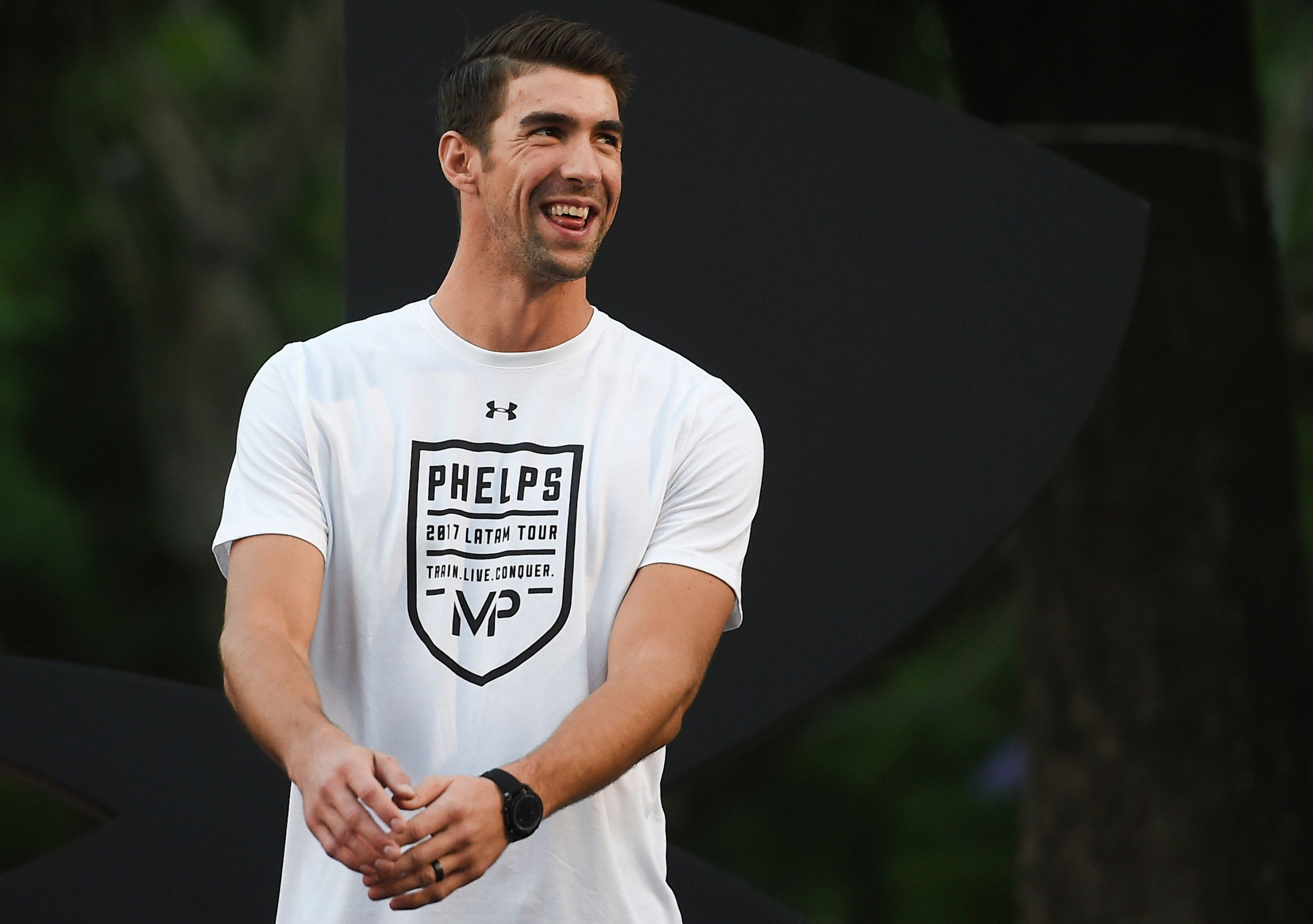 BUENOS AIRES, ARGENTINA - DECEMBER 07: Michael Phelps reacts during a visit to Argentina at El Rosedal Park on December 07, 2017 in Buenos Aires, Argentina. (Photo by Marcelo Endelli/Getty Images)